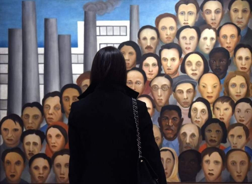 People look at the artwork during a press preview for artist Tarsila do Amaral: Inventing Modern Art in Brazil at the Museum of Modern Art on February 6, 2018 in New York